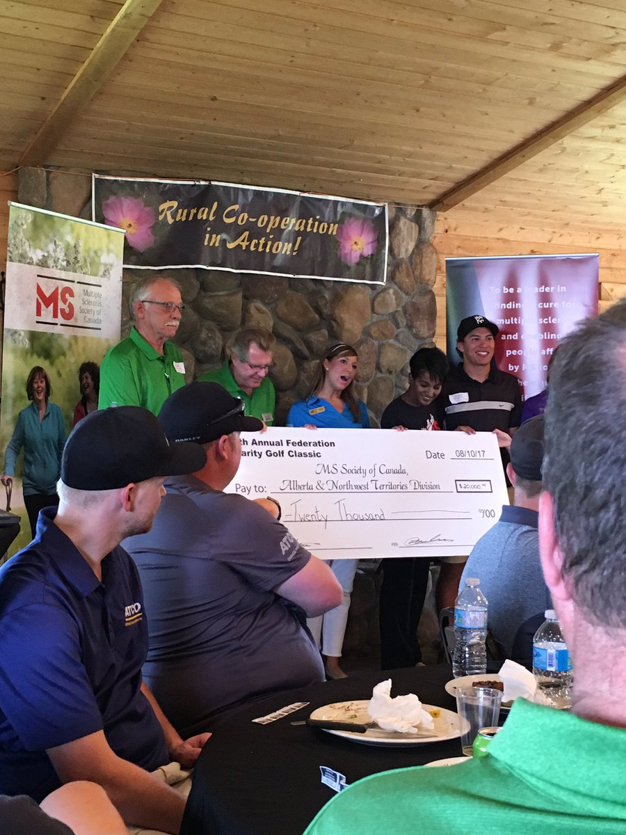 Cheque presentation at post-tournament BBQ